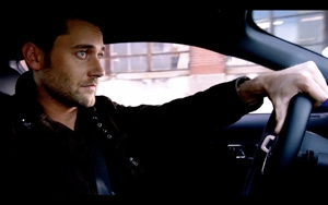 photo of Ryan Eggold  - car